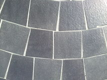 Steinmetzarbeit auf dem Boden Stockfotos