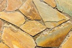 Steinmosaikhintergrund der gelben und goldenen Farbe Lizenzfreie Stockfotos