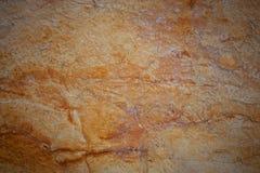 Steinoberfläche der orange Farbe Stockfoto