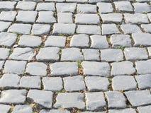 Steinpflasterungsbeschaffenheit einer alten Straße Alte Backsteinmauer Stockfotos