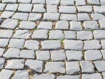 Steinpflasterungsbeschaffenheit einer alten Straße Alte Backsteinmauer Lizenzfreies Stockfoto