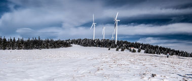 Steinriegel hill with wind turbines in winter Fischbacher Alpen mountains in Styria Royalty Free Stock Photography