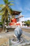 Steinschlange und Buddha lizenzfreies stockbild