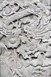 Steinschnitzen auf der Wand. Lizenzfreie Stockfotos