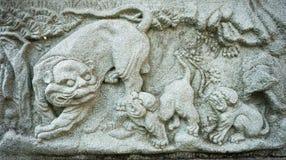 Steinschnitzen des chinesischen Löwes Stockbild