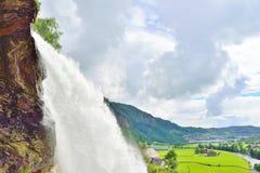 Steinsdalsfossen waterfall closeup and Norwegian countryside. Norheimsund, Norway Royalty Free Stock Image