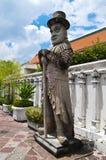 Steinstatue des alten Lords im Buddha-Tempel Stockfoto