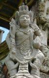 Steinstatue einer alten Gottheit Stockbilder