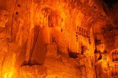 Steinstatue von Buddha in den Longmen Grotten Stockbilder