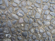 Steinwand-Beschaffenheitsfoto Stockfotografie
