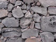 Steinwand der alten Lava Stockfoto