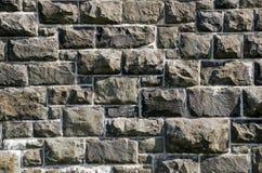 Steinwand des alten Granits lizenzfreie stockfotografie
