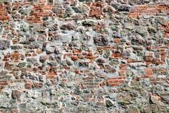 Steinwand des alten roten Backsteins Stockfotos