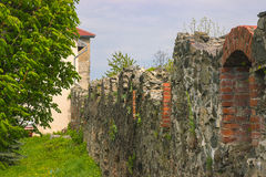 Steinwand des mittelalterlichen Schlosses Stockbild