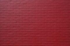 Steinwand des roten Backsteins Stockfotos
