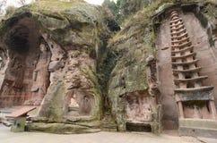 Steinwand-geschnitzte Statuen Stockbilder