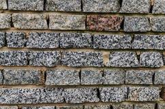 Steinwand-Hintergrund mit Stockfoto