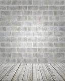 Steinwand mit Bretterboden Lizenzfreie Stockfotografie