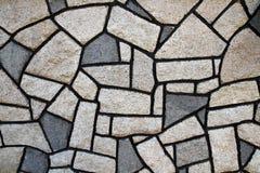 Steinwand mit Stein der unregelmäßigen Form Lizenzfreie Stockfotos
