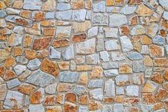 Steinwandbeschaffenheit und -hintergrund Stockfotografie