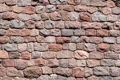 Steinwandhintergrund von Natursteinen Lizenzfreies Stockfoto