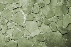 Steinwandhintergrund - Gebäudefunktion Beschaffenheit der starken und starken Wand der rauen Steine von verschiedenen Formen und  Lizenzfreies Stockfoto