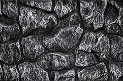 Steinwandhintergrund - Gebäudefunktion Beschaffenheit der starken und starken Wand der rauen Steine von verschiedenen Formen und  Stockbilder