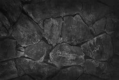 Steinwandhintergrund, schwarze Felsenbeschaffenheit im natürlichen Muster Stockbilder