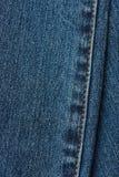 Steken op jeanstextuur Stock Afbeeldingen