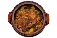 Stekgrisköttkött med isolerade potatisar Royaltyfria Bilder