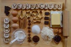 Stekheta ingredienser för julkakor Arkivfoto