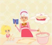 Stekheta kakor för mormor med hennes sondotter Royaltyfria Bilder
