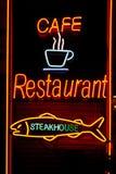 stekhus för cafeneonrestaurang Arkivbilder