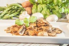 stekt champignon Arkivfoto
