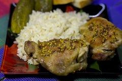 Stekt kyckling med ris och smaktillsats Royaltyfri Foto