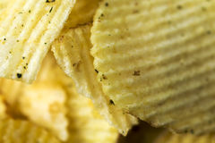 Stekt potatis, r�fflade chips n�rbild. Stock Photo