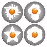 stekte ägg Figured stekte ägg på pannan Arkivbilder