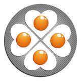 stekte ägg Figured stekte ägg på pannan Royaltyfri Bild