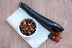 Stekte aubergine med tomater Royaltyfria Bilder