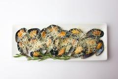 Stekte musslor i vasken på en platta Royaltyfri Bild