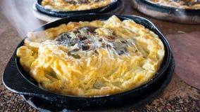 stekte ostroner för smet ägg Arkivbilder
