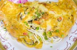 stekte ostroner för smet ägg Arkivfoto