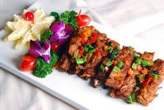 stekte porkstöd för porslin läcker mat fotografering för bildbyråer
