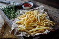 Stekte potatisar, fransman steker, snabbmatuppsättningen Royaltyfri Bild