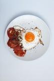 Stekte tomater för frukost ägg Royaltyfri Foto