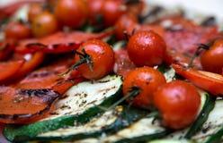 Stekte zucchini och körsbärsröda tomater Fotografering för Bildbyråer