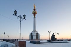 Stele and a monument in Yakutsk. Stele and the a monument the founder of Yakutsk P. I. Beketov Royalty Free Stock Photography