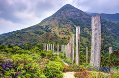 Wisdom Path on Lantau Island, Hong Kong. Steles containing centuries old sutra along Wisdom path at the hills of Ngong Ping on Lantau Island, Hong Kong, China Royalty Free Stock Photography