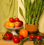 Still life with flower and fruits. Fruits  in the silver tray Stock Photos