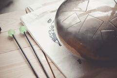 Stell Tongue Drum with Drum Sticks. Tank Drum royalty free stock image